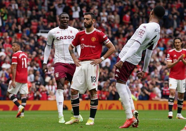 Manchester United's Bruno Fernandes (centre) reacts to his missed penalty against Aston Villa