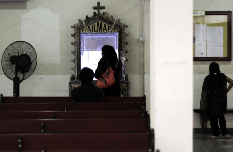 In this Thursday, Aug. 30, 2012 photo, worshipers pray at Sacred Heart Church in Manama, Bahrain. When Bahrain announced plans to build the largest Roman Catholic Church in the Gulf, it was accompanied by a noticeable dose of pride to showcase its traditions of religious tolerance. Instead, the planned church has turned into another point of tension in a country already being pulled apart by internal sectarian battles. (AP Photo/Hasan Jamali)
