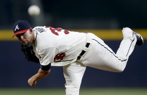 Atlanta Braves starting pitcher Mike Minor throws a pitch in the first inning of a baseball game against the New York Mets Saturday, Sept. 29, 2012, in Atlanta. (AP Photo/David Goldman)