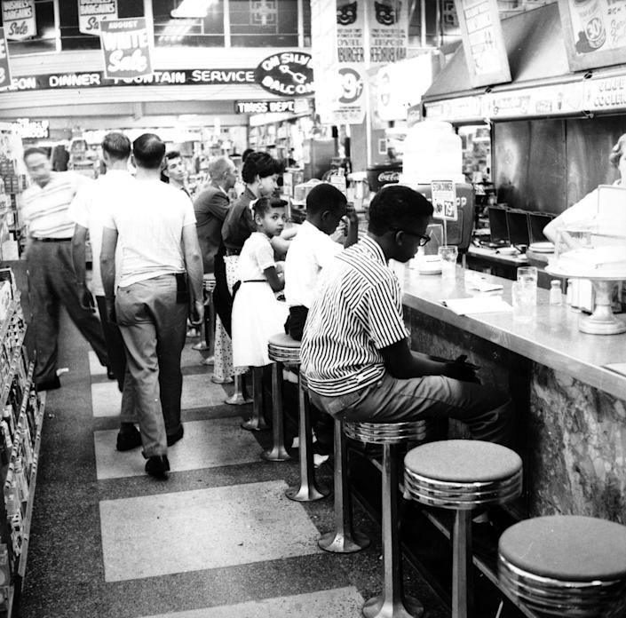 """<p>Due to segregation and Jim Crow laws, it was illegal for Black people to sit at the counters in many shops until 1964. Here, a sit-in takes place in Oklahoma City on August 26, 1958 to desegregate lunch counters. Many similar protests took place during the <a href=""""https://www.history.com/topics/black-history/civil-rights-movement"""" rel=""""nofollow noopener"""" target=""""_blank"""" data-ylk=""""slk:Civil Rights Movement"""" class=""""link rapid-noclick-resp"""">Civil Rights Movement</a>.</p>"""