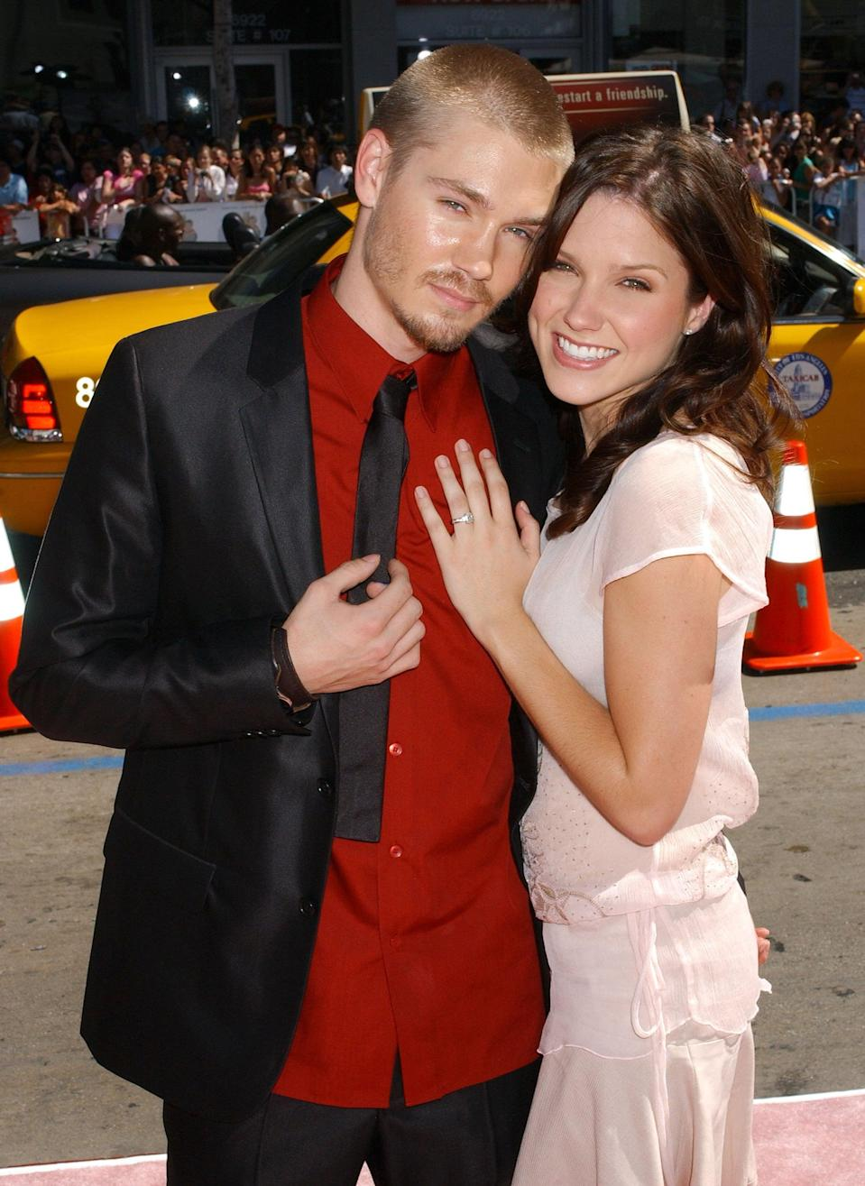 """<p>After meeting on the set of <strong>One Tree Hill </strong>in 2003, Sophia and Chad quickly fell in love and even tied the knot in 2005. Unfortunately, the couple filed for divorce only five months later, though they continued to star on the show as tumultuous couple Lucas and Brooke until Chad's departure in 2009. </p> <p>The former couple attempted to keep the peace on set following their divorce, but Sophia told <strong>Cosmopolitan</strong> in January 2017 that <a href=""""http://www.cosmopolitan.com/sex-love/a8579094/why-to-stop-seeking-the-one/"""" class=""""link rapid-noclick-resp"""" rel=""""nofollow noopener"""" target=""""_blank"""" data-ylk=""""slk:the experience was pretty difficult"""">the experience was pretty difficult</a>, and """"the trauma of [the breakup] was amplified by how public it became."""" Later, during a June 2018 appearance on <strong>Watch What Happens Live With Andy Cohen</strong>, <a href=""""http://www.bravotv.com/watch-what-happens-live-with-andy-cohen/season-11/videos/sophia-dishes-on-her-ex"""" class=""""link rapid-noclick-resp"""" rel=""""nofollow noopener"""" target=""""_blank"""" data-ylk=""""slk:Sophia said the relationship was a mistake"""">Sophia said the relationship was a mistake</a>. """"We were two stupid kids who had no business being in a relationship in the first place,"""" she added. </p>"""