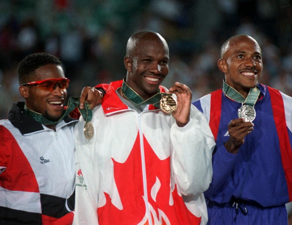 FILE - In this July 27, 1996, file photo, Bronze medalist Ato Boldon of Trinidad and Tobago, left, gold medalist Donovan Bailey of Canada, center, and silver medalist Frankie Fredericks of Namibia pose with their medals after the men's 100 meter final at the 1996 Summer Olympics in Atlanta. (AP Photo/David Longstreath, File)
