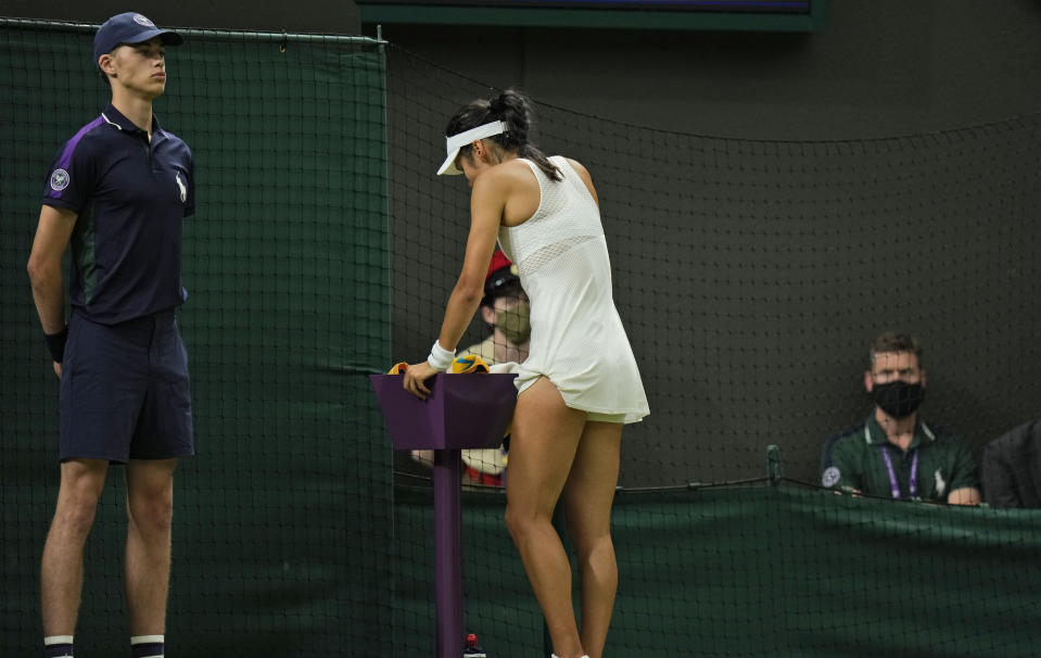 Britain's Emma Raducanu stands by the side before receiving medical attention during the women's singles fourth round match against Australia's Ajla Tomljanovic on day seven of the Wimbledon Tennis Championships in London, Monday, July 5, 2021. (AP Photo/Alastair Grant)