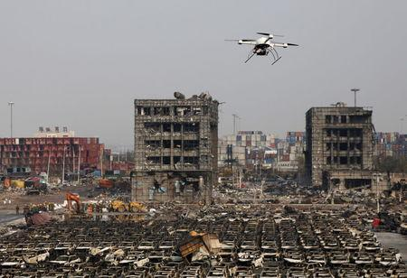A drone operated by paramilitary police flies over the site of last week's explosions at Binhai new district in Tianjin, China, August 17, 2015. REUTERS/Kim Kyung-Hoon
