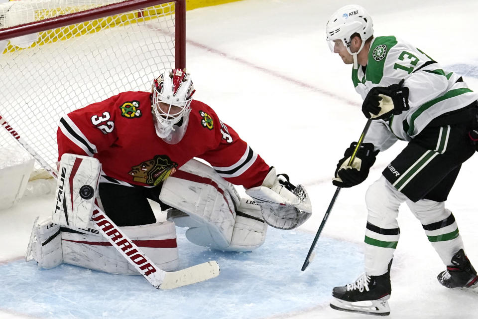 Chicago Blackhawks goaltender Kevin Lankinen, left, makes a save on a shot by Dallas Stars defenseman Mark Pysyk during the second period of an NHL hockey game in Chicago, Sunday, May 9, 2021. (AP Photo/Nam Y. Huh)