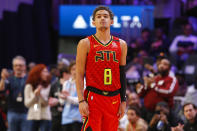 Atlanta Hawks guard Trae Young (11) wears a No. 8 jersey honoring former NBA player Kobe Bryant prior to an NBA basketball game against the Washington Wizards, Sunday, Jan. 26, 2020, in Atlanta. Bryant died in a California helicopter crash Sunday. (AP Photo/Todd Kirkland)