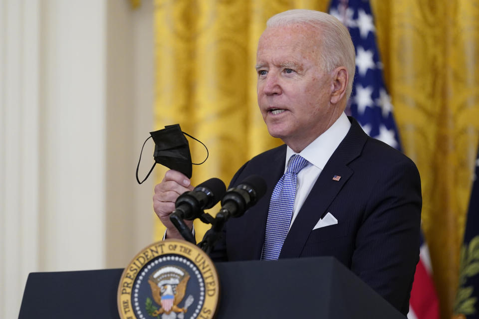 President Joe Biden holds a face mask as he announces from the East Room of the White House in Washington, Thursday, July 29, 2021, that millions of federal workers must show proof they've received a coronavirus vaccine or submit to regular testing and stringent social distancing, masking and travel restrictions in an order to combat the spread of the coronavirus. (AP Photo/Susan Walsh)