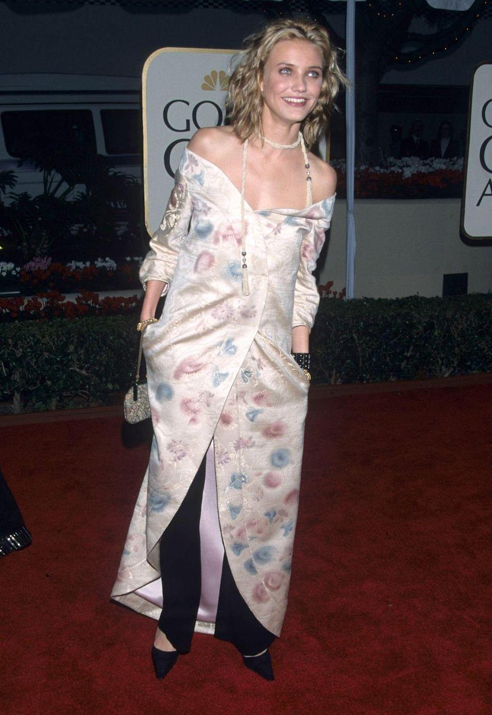 <p>At the Golden Globes, the star wore an off-the-shoulder printed duster over black pants and accessorized with a tasseled choker. I mean, can you even imagine her wearing something like this today? </p>