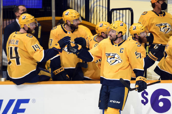 Nashville Predators defenseman Roman Josi (59) is congratulated after scoring a goal against the Tampa Bay Lightning during the first period of an NHL hockey game Tuesday, April 13, 2021, in Nashville, Tenn. (AP Photo/Mark Zaleski)