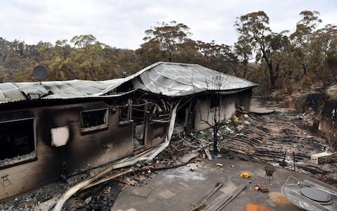 A view of a house damaged by recent catastrophic bushfires in the Southern Highlands village of Balmoral - Credit: Rex