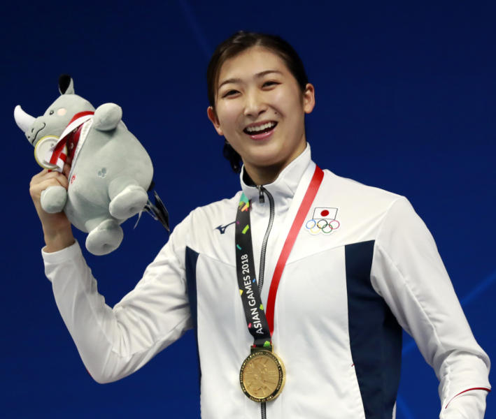 FILE - In this Aug. 20, 2018, file photo, Japan's Rikako Ikee poses on the podium after winning the women's 100m freestyle final during the swimming competition at the 18th Asian Games in Jakarta, Indonesia. Ikee, the favorite for the 100-meter butterfly for the 2020 Tokyo Olympics, has been diagnosed with leukemia. Ikee said on her verified Twitter account Tuesday, Feb. 12, 2019, her illness surfaced when she got tests after returning from Australia not feeling well. (AP Photo/Bernat Armangue, File)