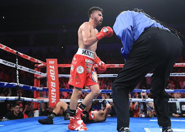 Jose Ramirez heads to a neutral corner after knocking Antonio Orozco down with a body shot in their WBC super lightweight world title fight Friday. (Top Rank)