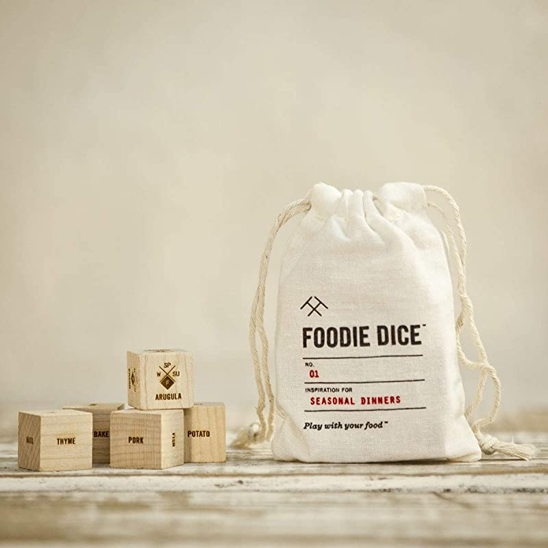 """<h2>Foodie Dice</h2><br>Having trouble deciding what to cook for dinner? Well, here's your answer. Roll the dice for over 186,000 possible meal combinations to inspire you.<br><br><strong>Two Tumbleweeds Store</strong> Foodie Dice®, No. 1 Seasonal Dinners, $, available at <a href=""""https://amzn.to/3gpTKyo"""" rel=""""nofollow noopener"""" target=""""_blank"""" data-ylk=""""slk:Amazon"""" class=""""link rapid-noclick-resp"""">Amazon</a>"""