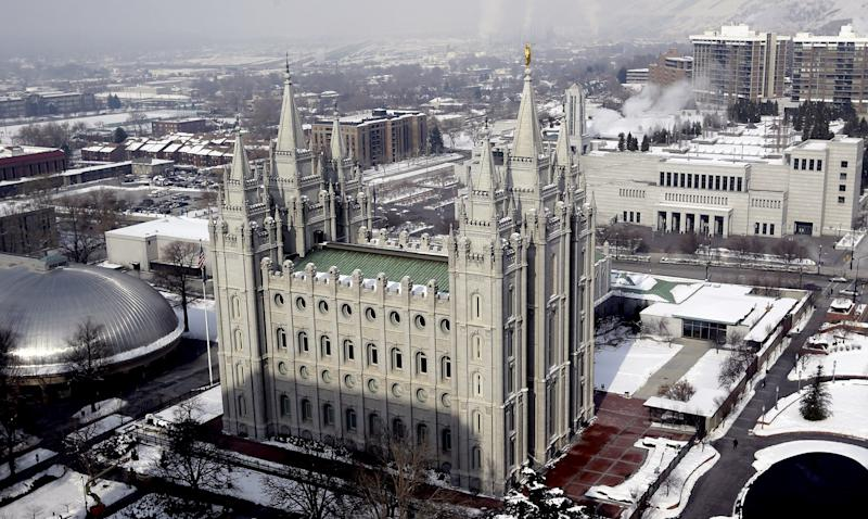 """This Jan. 22, 2013 photo shows the Salt Lake Temple, at Temple Square, in Salt Lake City. Mormon church officials and Boy Scout leaders in Utah applauded the Boy Scouts of America for putting off a decision Wednesday on lifting its ban on gay members and leaders. The policy under consideration would let troop sponsors make their own decisions about leaders and youth members. Boy Scouts of America """"acted wisely in delaying its decision until all voices can be heard on this important moral issue,"""" said Michael Purdy, spokesman for The Church of Jesus Christ of Latter-day Saints. The church will continue to closely monitor the proposed policy change, Purdy said. (AP Photo/Rick Bowmer)"""