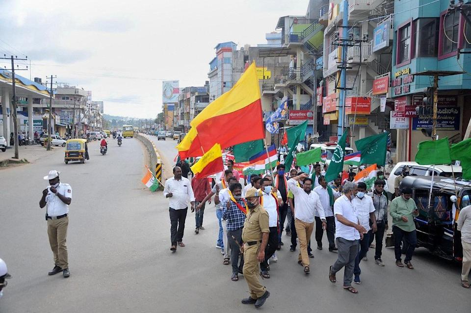 """<div class=""""paragraphs""""><p>Chikmagalur: Farmers association members protest to support farmers Bharat Bandh against central governments three farm reform laws.</p></div>"""