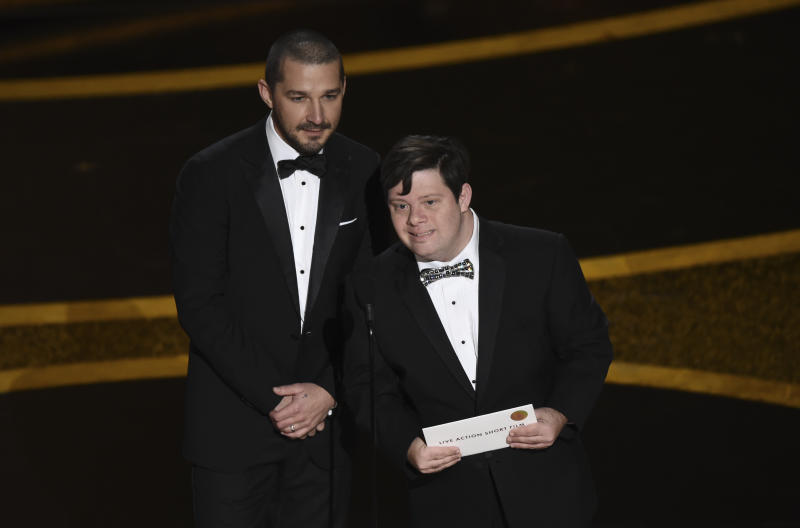 Shia LaBeouf, left, and Zack Gottsagen present the award for best live action short film at the Oscars on Sunday, Feb. 9, 2020, at the Dolby Theatre in Los Angeles. (AP Photo/Chris Pizzello)