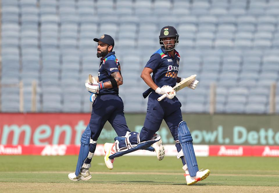 PUNE, INDIA - MARCH 26: India batsmen Virat Kohli (l) and KL Rahul pick up some runs during the 2nd One Day International between India and England at MCA Stadium on March 26, 2021 in Pune, India. (Photo by Surjeet Yadav/Getty Images)
