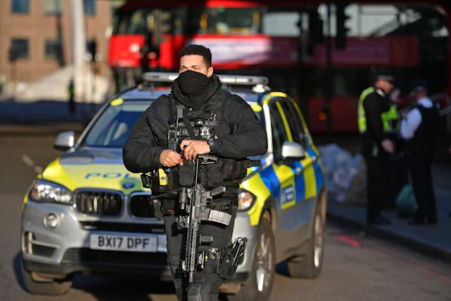 Armed police and emergency services at the scene of an incident on London Bridge in central London. Photo: PA