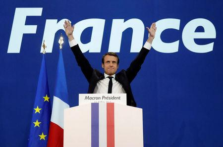 Macron, head of the political movement En Marche !, or Onwards !, and candidate for the 2017 French presidential election, celebrates after partial results in the first round of 2017 French presidential election, in Paris