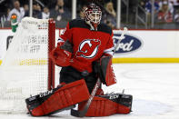 New Jersey Devils goaltender Louis Domingue makes a save against the Tampa Bay Lightning during the first period of an NHL hockey game Sunday, Jan. 12, 2020, in Newark, N.J. (AP Photo/Adam Hunger)
