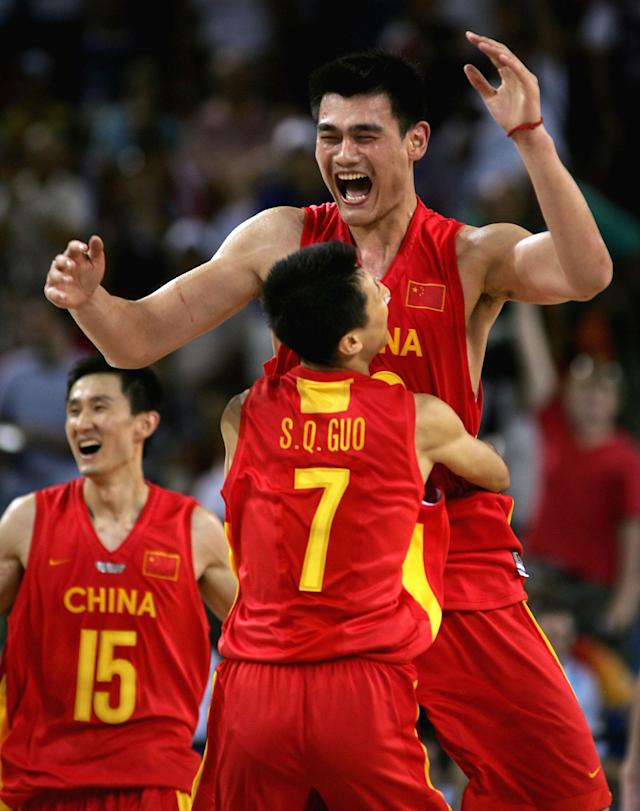 ATHENS - AUGUST 23: Yao Ming #13 and Shiqiang Guo #7 of China celebrate their 67-66 win over Serbia & Montenegro in the men's basketball preliminary game on August 23, 2004 during the Athens 2004 Summer Olympic Games at the Indoor Arena of the Helliniko Olympic Complex in Athens, Greece. (Photo by Stuart Hannagan/Getty Images)
