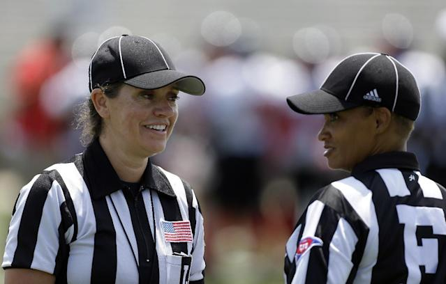 IMAGE DISTRIBUTED FOR NATIONAL FOOTBALL LEAGUE - Line Judge Catherine Conti huddles with field judge Sebrina Brunson at the Legacy Bowl Women's Football Championship, on Friday July 25, 2014 at District Three Stadium in Rock Hill, S.C. The Carolina Queens beat the Minnesota Vixens 28-22. (Bob Leverone/AP Images for National Football League)