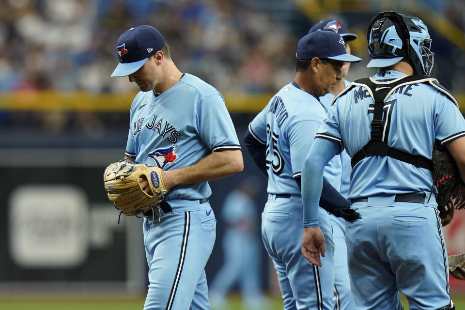 Toronto Blue Jays pitcher Ross Stripling, left, is relieved by manager Charlie Montoyo during the third inning of a baseball game against the Tampa Bay Rays Wednesday, Sept. 22, 2021, in St. Petersburg, Fla. (AP Photo/Chris O'Meara)