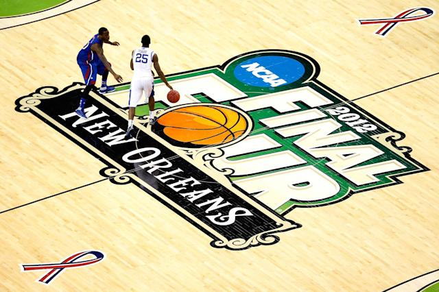 Marquis Teague #25 of the Kentucky Wildcats moves the ball up court against Tyshawn Taylor #10 of the Kansas Jayhawks in the second half in the National Championship Game of the 2012 NCAA Division I Men's Basketball Tournament at the Mercedes-Benz Superdome on April 2, 2012 in New Orleans, Louisiana. (Photo by Chris Graythen/Getty Images)