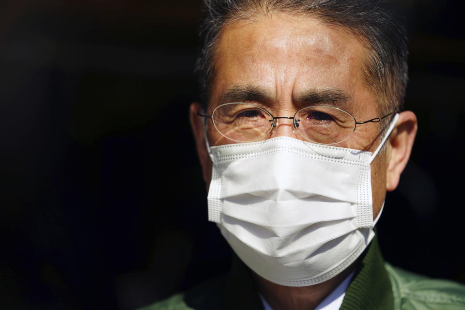 Yasuo Takamatsu speaks with The Associated Press at Onagawa, Miyagi prefecture, northern Japan on Monday, March 8, 2021. Takamatsu, 64, lost his wife, Yuko, when a tsunami hit Onagawa, on March 11, 2011, in Miyagi prefecture. He has been looking for her ever since. He even got his diving license to try to find her remains, and for seven years he has gone on weekly dives. (AP Photo/Eugene Hoshiko)