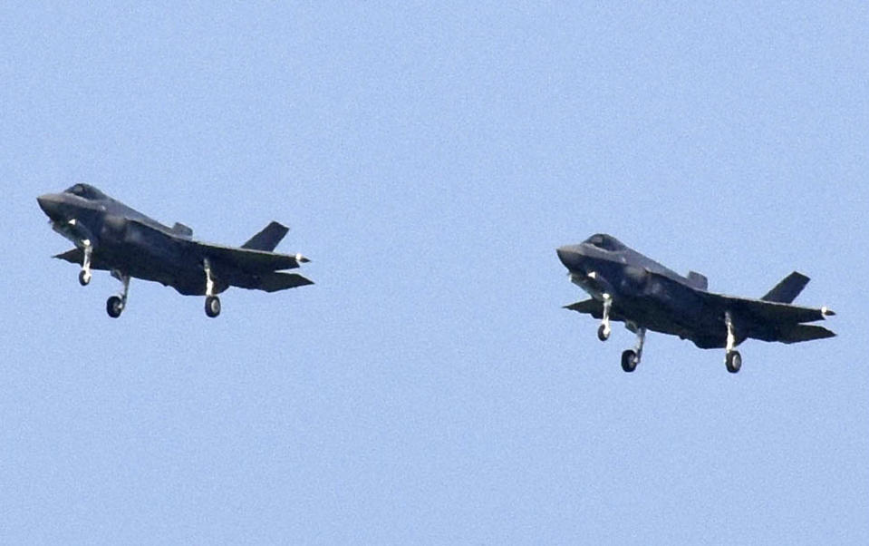 In this Aug. 1, 2019, photo, Japanese Air Self-Defense Force's F-35A stealth fighter jets prepare to land at Misawa Air Base in Misawa, northern Japan. Japan approved Friday, Dec. 20 ,2019, a draft defense budget that included cost to develop own fighter jets to succeed the nation's aging warplanes and import some of F-35 stealth fighters as components for assembly at home rather than importing the expensive American warplanes as finished products to reduce costs and acquire expertise. (Kyodo News via AP)