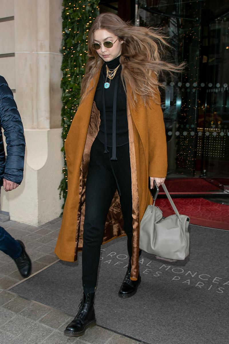 Gigi Hadid wore the coat of the season to hide her sweats. (Credit: Getty Images)