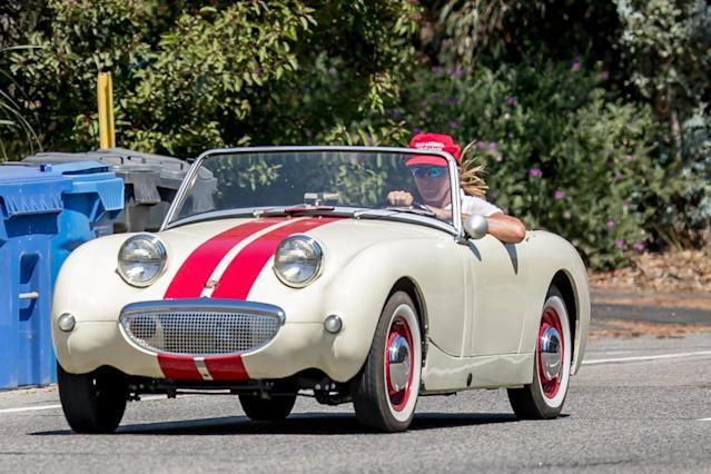 "Caitlyn Jenner wears a red ""Make America Great Again"" (MAGA) while cruising her classic car in Malibu, Calif., on Aug. 3, 2017.  (Photo: MEGA)"