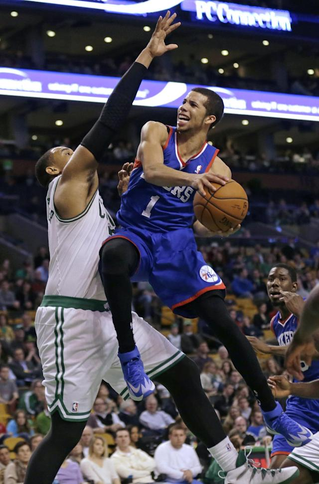 Philadelphia 76ers guard Michael Carter-Williams (1) drives to the basket against Boston Celtics center Jared Sullinger, left, during the second half of an NBA basketball game Friday, April 4, 2014, in Boston. Carter-Williams had 24 points in the 76ers 111-102 win. (AP Photo/Charles Krupa)