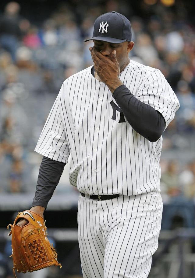 File-This May 4, 2014, file photo shows New York Yankees starting pitcher CC Sabathia coming out out of a baseball game against the New York Yankees at Yankee Stadium in New York. The Yankees have placed Sabathia on the 15-day disabled list with inflammation in his right knee. The move Sunday, May 11, 2014, comes a day after the left-hander allowed three home runs in a no-decision against the Brewers. (AP Photo/Kathy Willens, File)