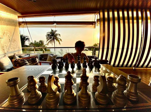 Hrithik finds the perfect spot to play a game of chess with his son, as he watches the sun set from his big and cozy looking balcony.