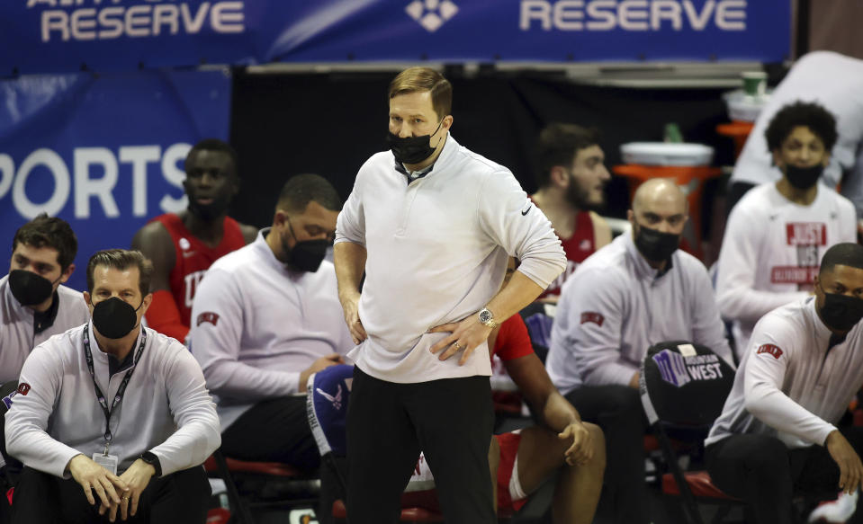 UNLV head coach T.J. Otzelberger watches his team during the second half of an NCAA college basketball game against Utah State in the quarterfinals of the Mountain West Conference men's tournament Thursday, March 11, 2021, in Las Vegas. (AP Photo/Isaac Brekken)