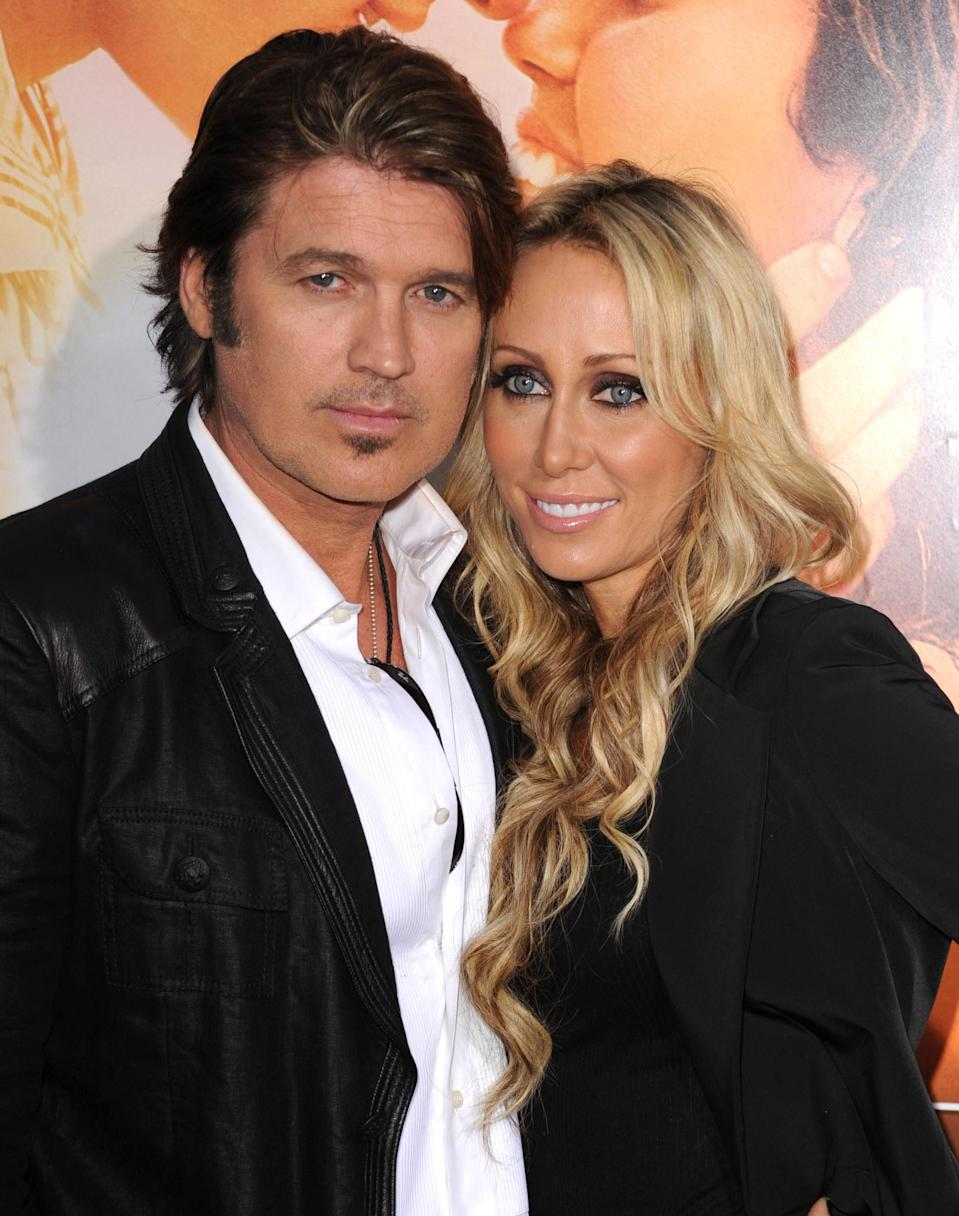 Billy Ray Cyrus showed his wife, Tish (pictured with him in 2010), posing in front of a large stash of marijuana. (Photo: Steve Granitz/WireImage)