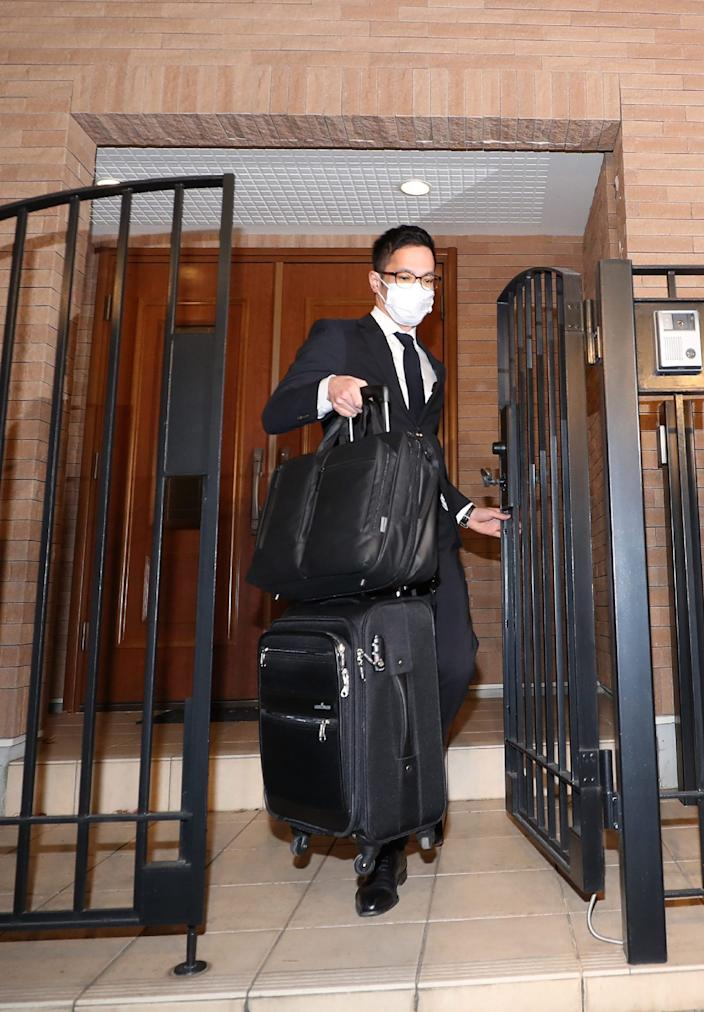 A Japanese prosecutor carries bags as he leaves the residence of former auto tycoon Carlos Ghosn in Tokyo on January 2, 2020, after Ghosn fled Japan to avoid a trial. - Former Nissan boss Carlos Ghosn, who fled to Lebanon to avoid a Japanese trial, had a second French passport, a source said on January 2, as authorities raided his Tokyo residence as part of a probe into the embarrassing security lapse. (Photo by STR / JIJI PRESS / AFP) / Japan OUT (Photo by STR/JIJI PRESS/AFP via Getty Images)