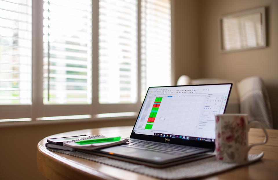 File photo dated 04/03/20 of a laptop on a dining room table set up as a remote office to work from home. One in three British workers does not think they will not be back in their office or other workplace until at least next year, according to a new survey.
