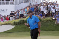 Patrick Reed pumps his fist on the 18th hole as he wins on the Northern Trust golf tournament at Liberty National Golf Course, Sunday, Aug. 11, 2019, in Jersey City, N.J. (AP Photo/Mark Lennihan)