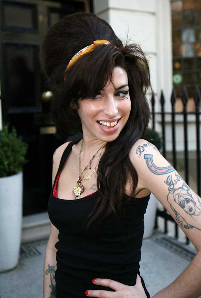 "Amy Winehouse emerged from the dentist's office Saturday showing off her brand new crown. The British singer was slated to perform at Sunday's Grammy Awards (where she is nominated for six awards), but her visa was denied, only to be approved too late. Instead, Winehouse will perform live via satellite from her native U.K. <a href=""http://www.splashnewsonline.com"" target=""new"">Splash News</a> - February 9, 2008"