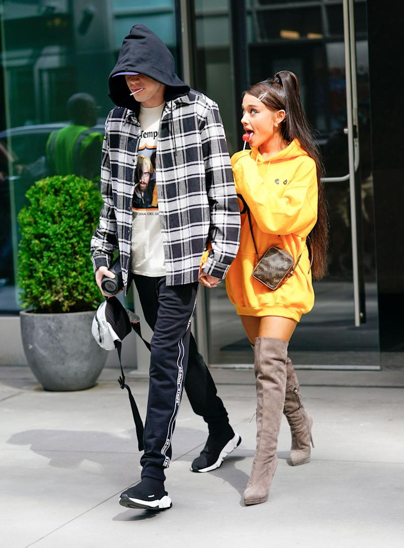 Pete Davidson and Ariana Grande in the street