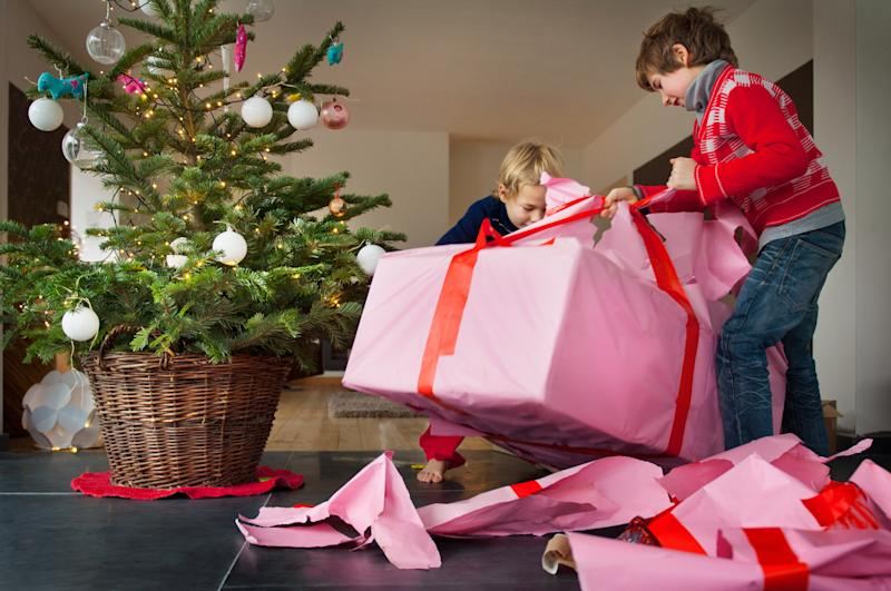 Children can be overwhelmed by lots of gifts on Christmas morning [Photo: Getty]