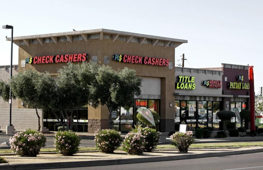 Signs adorn this payday loan business, one of 650 operating in the state and some open 24 a day in Phoenix in 2010.