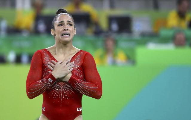 2016 Rio Olympics - Artistic Gymnastics - Final - Women's Individual All-Around Final - Rio Olympic Arena - Rio de Janeiro, Brazil - 11/08/2016. Alexandra Raisman (USA) of the U.S. reacts after winning the silver medal. REUTERS/Mike Blake FOR EDITORIAL USE ONLY. NOT FOR SALE FOR MARKETING OR ADVERTISING CAMPAIGNS.