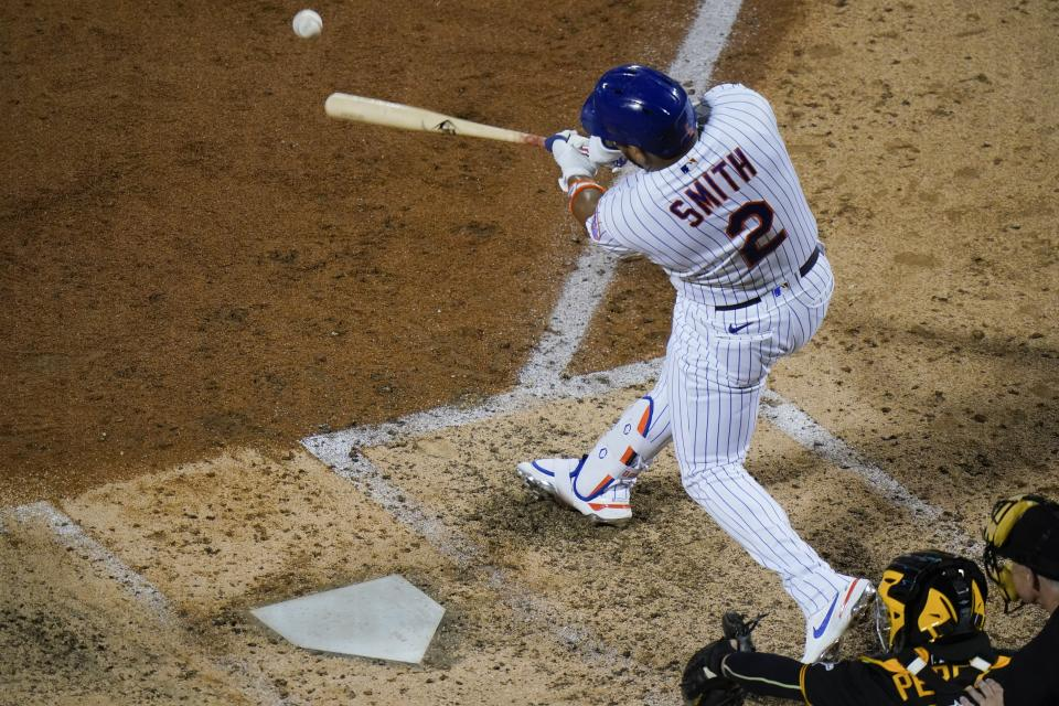 New York Mets' Dominic Smith (2) hits an RBI-single during the sixth inning of a baseball game against the Pittsburgh Pirates Friday, July 9, 2021, in New York. (AP Photo/Frank Franklin II)