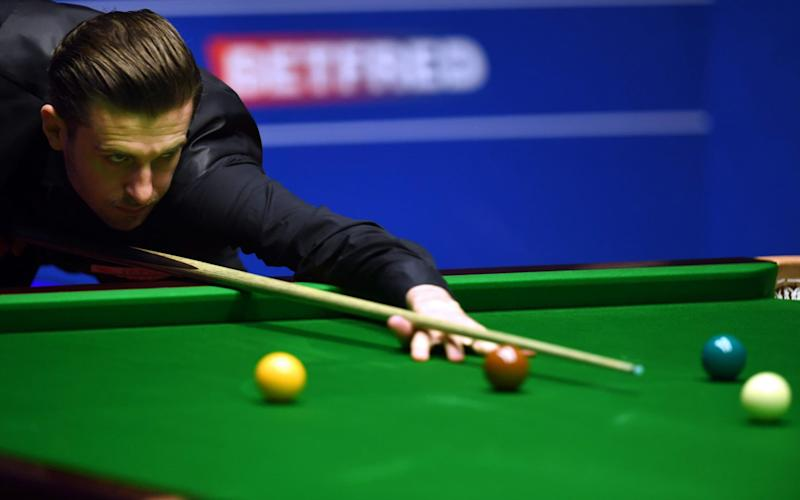 Selby made a break of 131 in the 32nd frame to move within one of the title - Credit: PAUL ELLIS/AFP