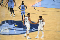 Utah Jazz center Rudy Gobert (27) and guard Donovan Mitchell (45) congratulate each other at the end of Game 3 of an NBA basketball first-round playoff series against the Memphis Grizzlies, Saturday, May 29, 2021, in Memphis, Tenn. Utah won 121-111. (AP Photo/John Amis)