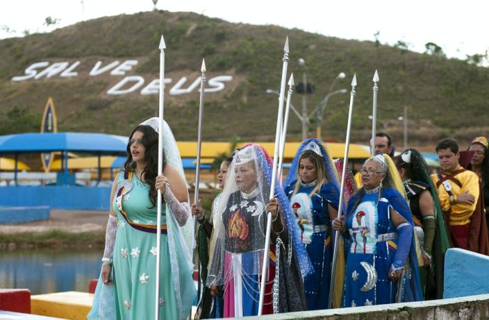 """<span class=""""caption"""">Valley of the Dawn members celebrate 'Day of the Indoctrinator' at their temple complex in Brazil on May 1. This year's event is postponed due to coronavirus.</span> <span class=""""attribution""""><span class=""""source"""">Márcia Alves</span>, <a class=""""link rapid-noclick-resp"""" href=""""http://creativecommons.org/licenses/by-sa/4.0/"""" rel=""""nofollow noopener"""" target=""""_blank"""" data-ylk=""""slk:CC BY-SA"""">CC BY-SA</a></span>"""