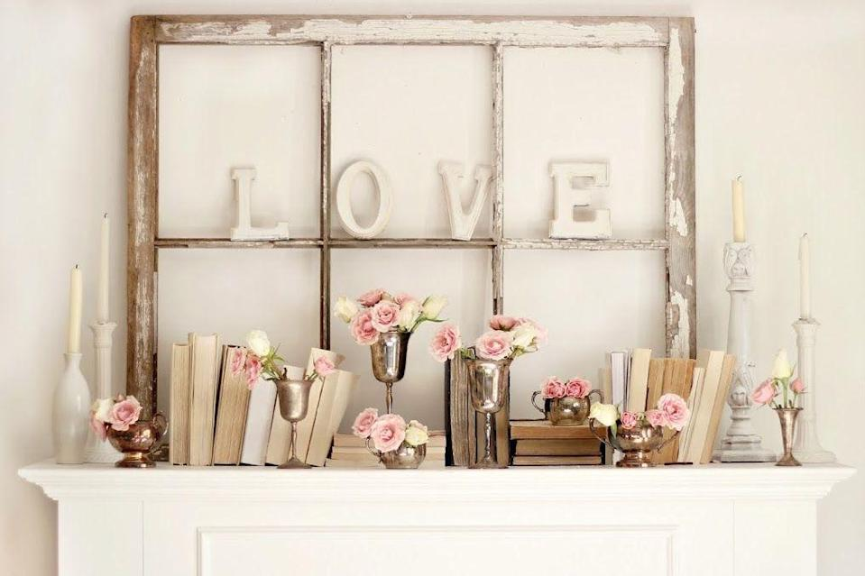 """<p>Stage a soft and romantic Valentine's Day scene on your mantel with a worn windowpane, shabby chic """"LOVE"""" lettering, and blush pink roses.</p><p><em><a href=""""http://www.craftberrybush.com/2013/02/valentines-day-mantel.html"""" rel=""""nofollow noopener"""" target=""""_blank"""" data-ylk=""""slk:Get the tutorial at Craftberry Bush »"""" class=""""link rapid-noclick-resp"""">Get the tutorial at Craftberry Bush »</a></em></p>"""